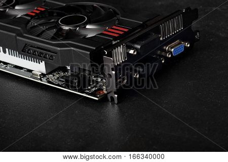 video card with two coolers from the computer on a dark background.concept computer harware.copy space