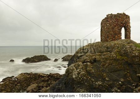 A view of an old stone tower on the headland at Elie