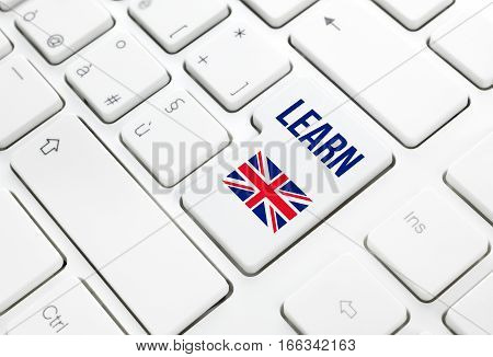 Learn English language education web concept. United Kingdom flag enter button or key on white keyboard