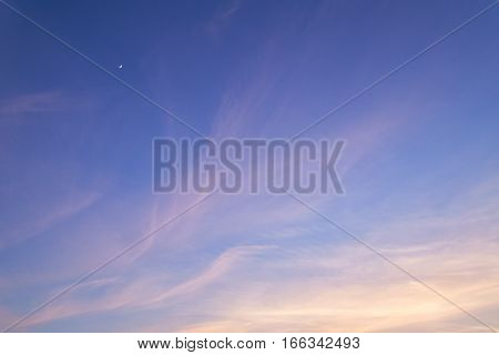 Beautiful cirrus clouds in evening sky. Sunset