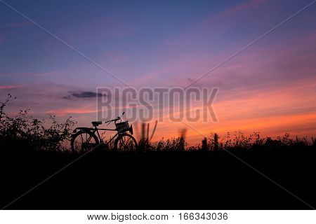Bicycle Silhouette In Nature Sunset Golden Hour Evening With Twilight Sky Background.