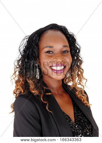 A closeup image of a beautiful African American woman in a black dress and curly brunette hair isolated for white background.
