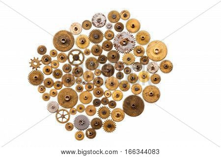Steampunk ornament style and mechanical design on white background. Vintage clockwork parts closeup. Abstract shape object with many textured cogs gears wheels. Golden silver shabby surface objects