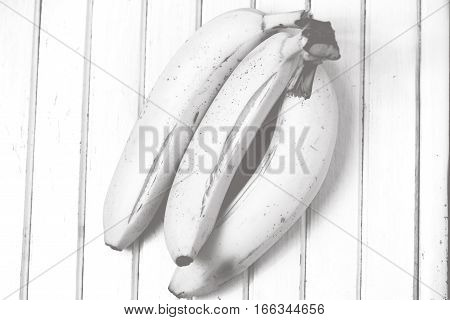 Ripe three bananas on a vintage surface black and white