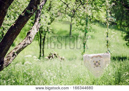 riding swing in park. Green garden  in summer