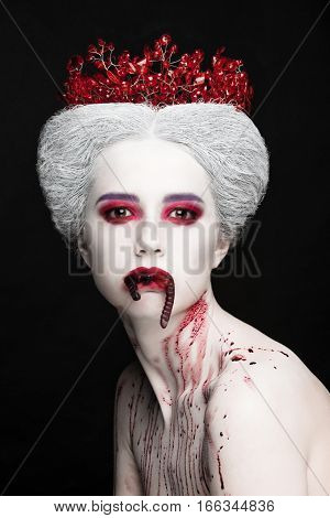 Mysterious Beauty Portrait Of Snow Queen Covered With Blood. Bright Luxury Makeup. Jelly Worms In Th