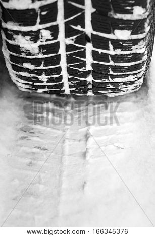 Car tire on a fresh winter snow.