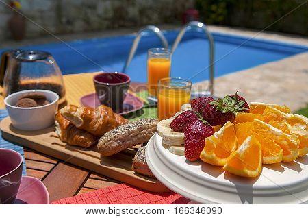 healthy breakfast at pool side, fruits, coffee