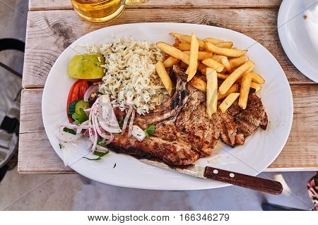 The lamb grilled in a Greek taverna on the island of Kos