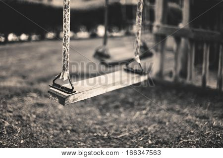 Monochrome Image Empty Swing At The Playground In Summer, Horizontal