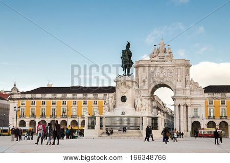Lisbon Portugal - february 18 2014: Triumphal arch connecting the Commerce Square to the Augusta Street. It has a clock and statues of Viriatus Nuno Álvares Pereira Vasco da Gama and Marquis of Pombal