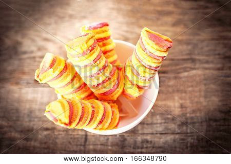 Fruit Ice cream sticks on wooden table. Popsicles sorbet ice-cream with copyspace