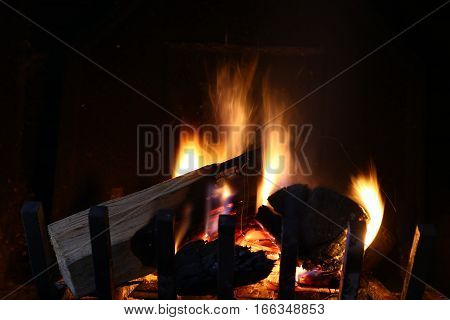 burning Wood logs in a chimney fire
