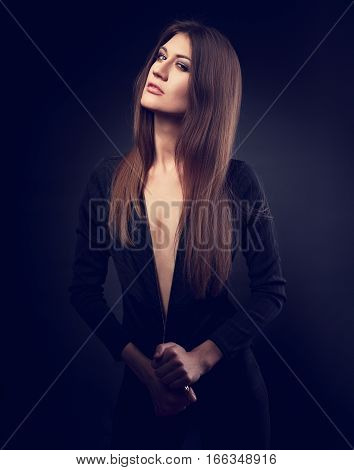 Sexy Slim Model Posing In Black Jacket With Long Stright Hair Style And Long Neck On Dark Background
