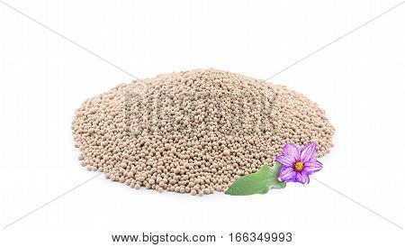 Heap of composite mineral fertilizers with leaf and flower isolated on the white background