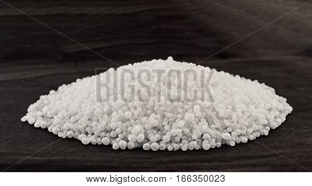 Mineral fertilizers balls - carbamide (urea) on a black background