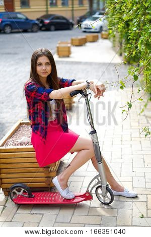 Portrait Of Teenage Girl With Kick Scooter