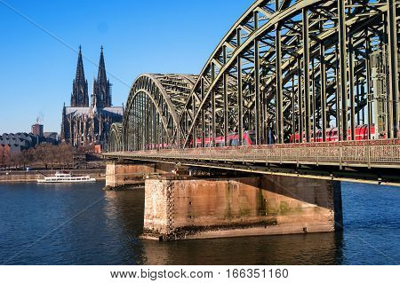 Cologne Cathedral and Hohenzollern Bridge. The Cathedral, built in Gothic style in honor of St. Peter the Apostle and the Virgin Mary.