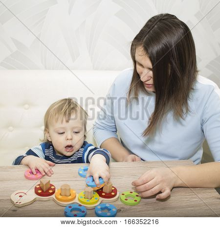 little boy and his mom play in developing the game.