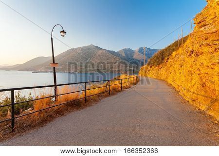 Morning landscape with lamps near the road mountains and sea. Village Bali island Crete Greece.