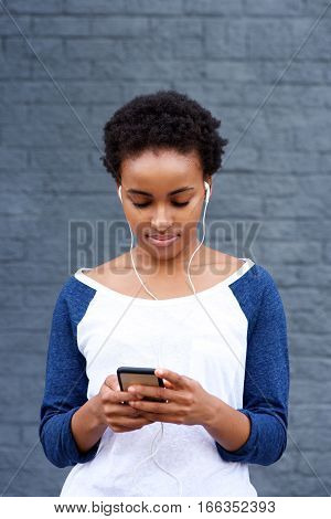 Cool Young Woman Listening To Music With Mp3 Player
