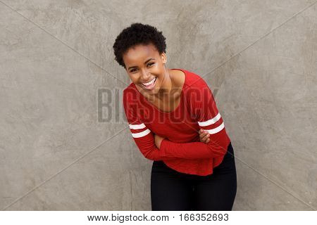 Beautiful Young Black Woman Laughing With Arms Crossed