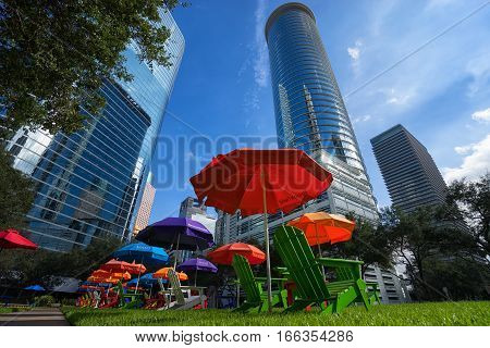 December 29 2015 Houston Texas: colourful patio chairs on green grass in the financial district offer a resting spot for office workers