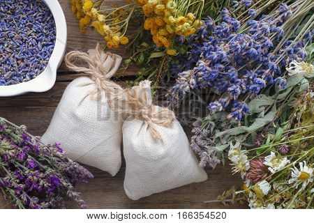 Bunch Of Healing Herbs, Mortar And Sachet On Wooden Table. Top View, Flat Lay.