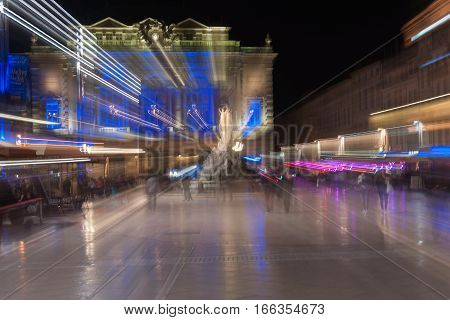 September 29, 2016, Zoom blur images at night in the Place de la Comédie wonderful architecture and Three Graces fountain on promenade under night lights and long exposure Place de la Comédie Montpellier France urban & architectural