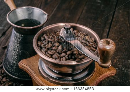 Close up handle coffee grinder with beans