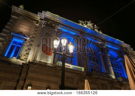 Montpelier, France - September 29, 2016: Night in the Place de la Comedie wonderful architecture of historic Opera House on  promenade under night lights and long exposure Montpellier France urban & architectural