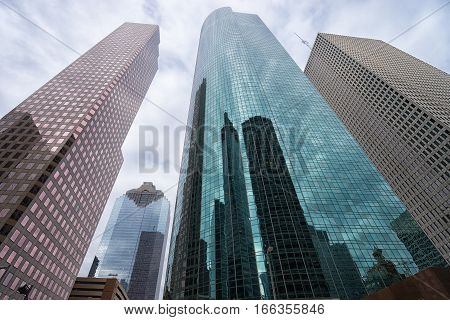 December 29, 2015 Houston Texas: modern steel and glass high-rise buildings agains the cloudy sky in the financial district