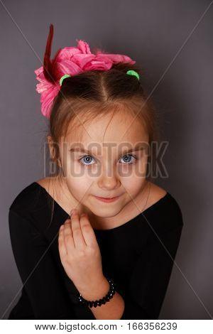 Beautiful little girl in a black leotard in a dancing class