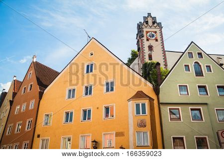 Facades of old buildings and Hohes Schloss in Fussen Bavaria Germany
