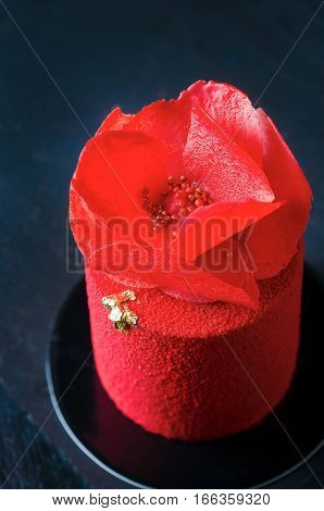 Cake with strawberry mousse under a red chocolate velor cover