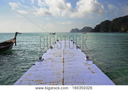 beautiful marine landscape view of sea mountains and long tail boat at koh phi phi island in Thailand in Krabi province South Asia in holiday and vacation travel and tourist destination concept