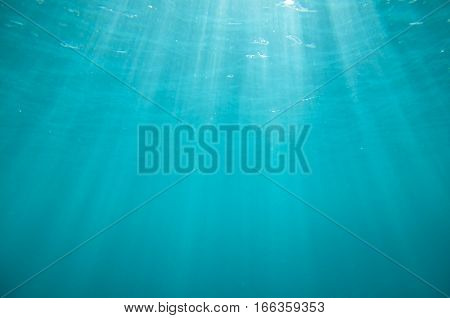 Underwater blue background with sun ray lights