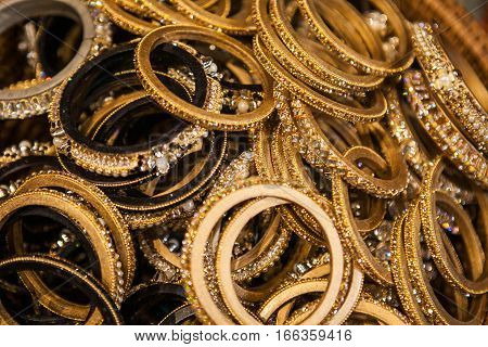 Set of traditional indian golden bracelets on a market. Authentic jewelry