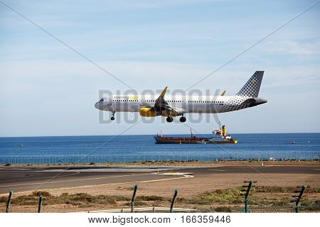 ARECIFE, SPAIN - DESEMBER, 2 2016:  Airbus A321 of Vueling landing at Lanzarote Airport