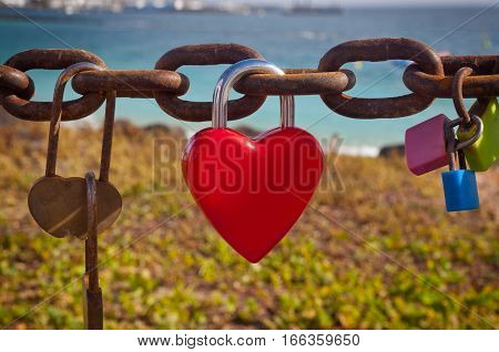 Heart shaped padlock by the sea - love concept