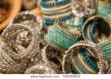Set of traditional indian bracelets on a market. Authentic jewelry