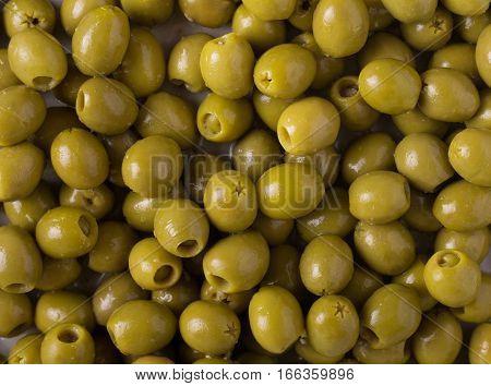 Background of olives. Background with green olives. Olives. Olive