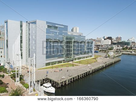 The view of Halifax city wooden waterfront with modern building behind (Nova Scotia Canada).