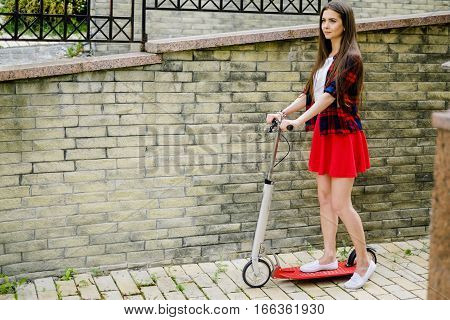 Woman Travelling By Scooter