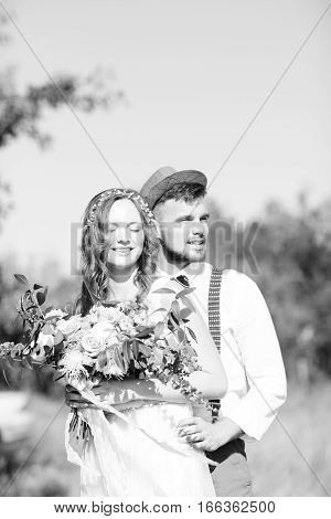black and white photo. bride and groom hugging at the wedding in nature.