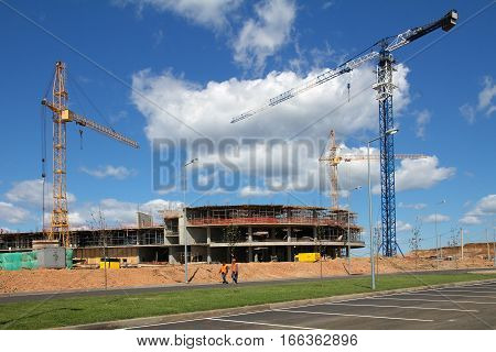 Building cranes and a building under construction