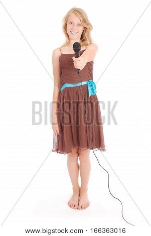 Teenage girl holding a microphone in front. Isolated on white background