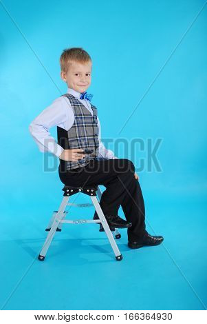 Boy in school uniform on the blue background