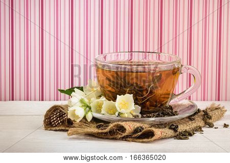 Cup of jasmine tea with  jasmine  flowers