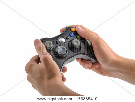 Male Hands Holding Gamepad isolated on white background